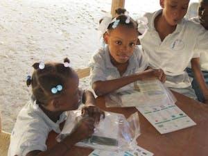Distributing hygiene kits in school