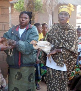 Kyala Bangwe Ernata on the left with her first chicken.
