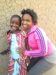 Cynthia with Carine, her FH staff monitor.