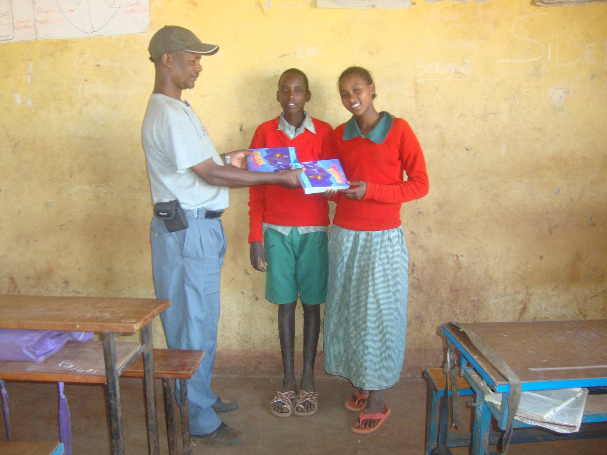 FH Staffer Wario, Delivering Books to Lkisomai (center) and Sabadei