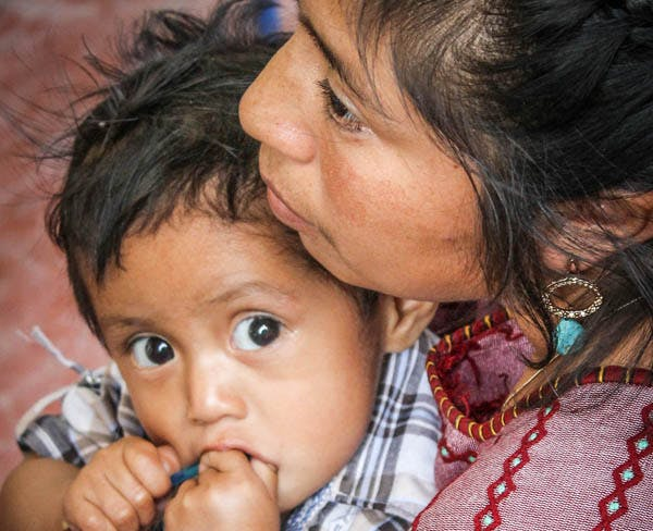 Mother and Child at Food for the Hungry feeding center in Guatemala