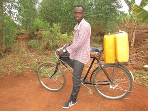 Bicycles provided by Exposition Church help people fetch clean water as well as take products to market.