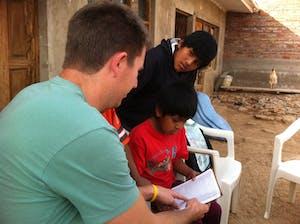 Missions program member works with Ushpa Ushpa children