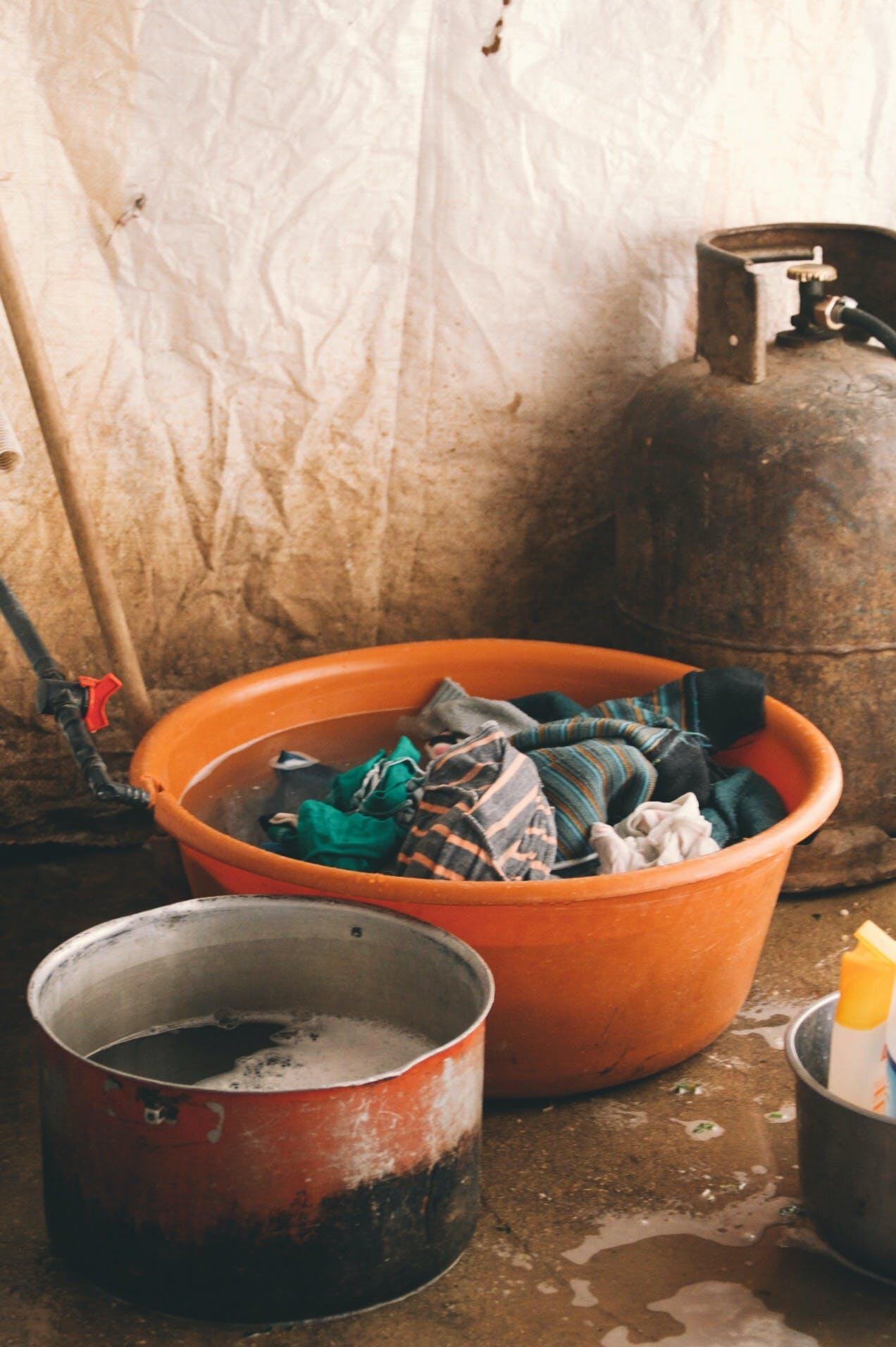 Rasmia washes laundry inside her small home in Lebanon.