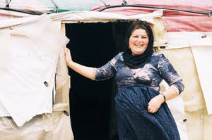 Rasmia stands outside of her home in a refugee settlement just a 20-minute drive from Syria.