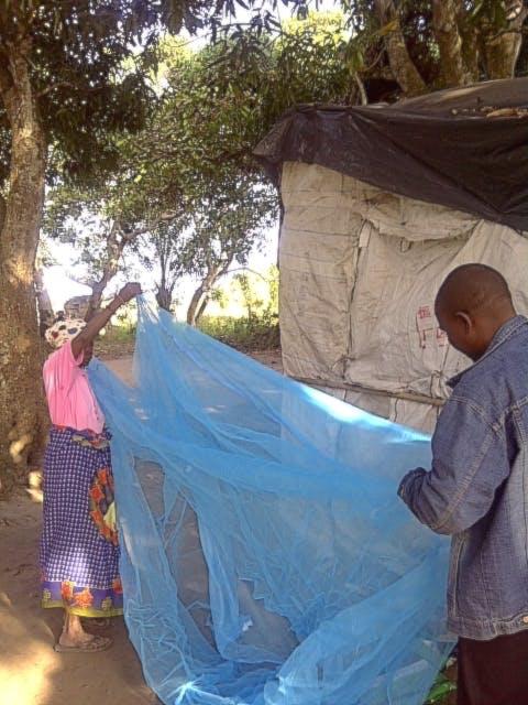 Mozambique malaria prevention. Net distribution