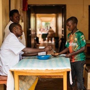 Boy in Burundi receives deworming tablet