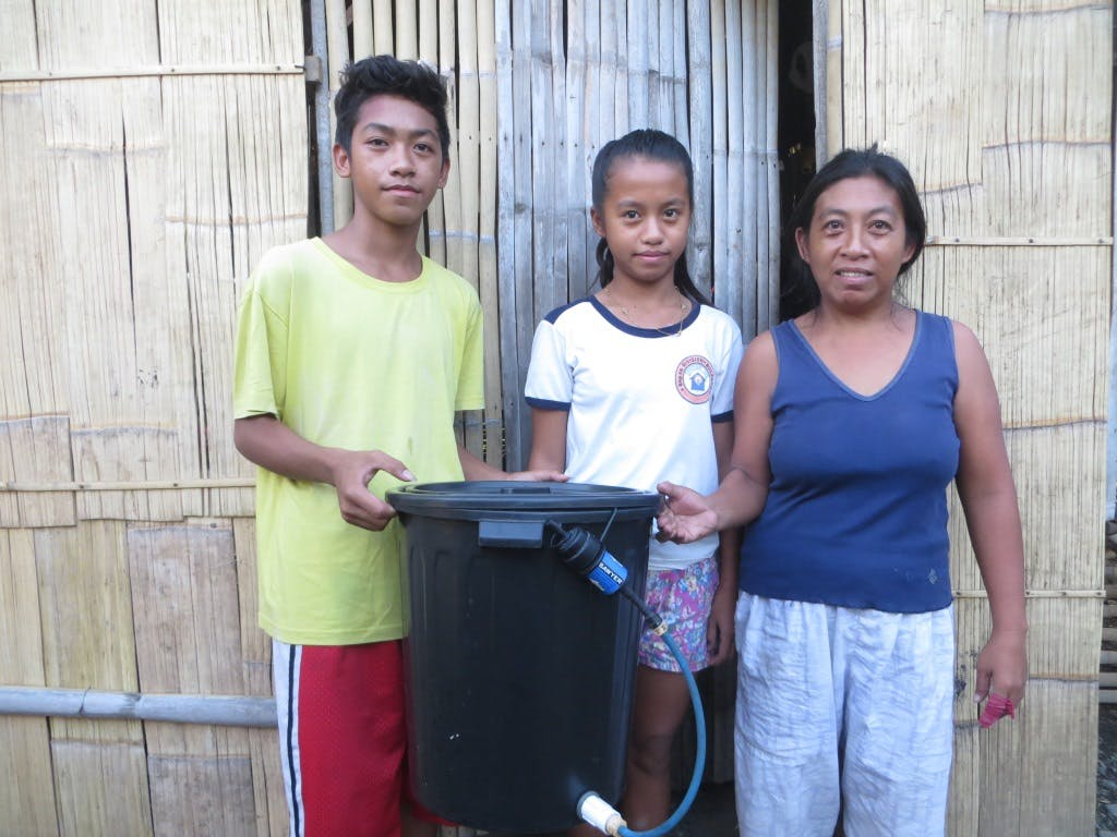 This family now has clean water because of a filtration system.