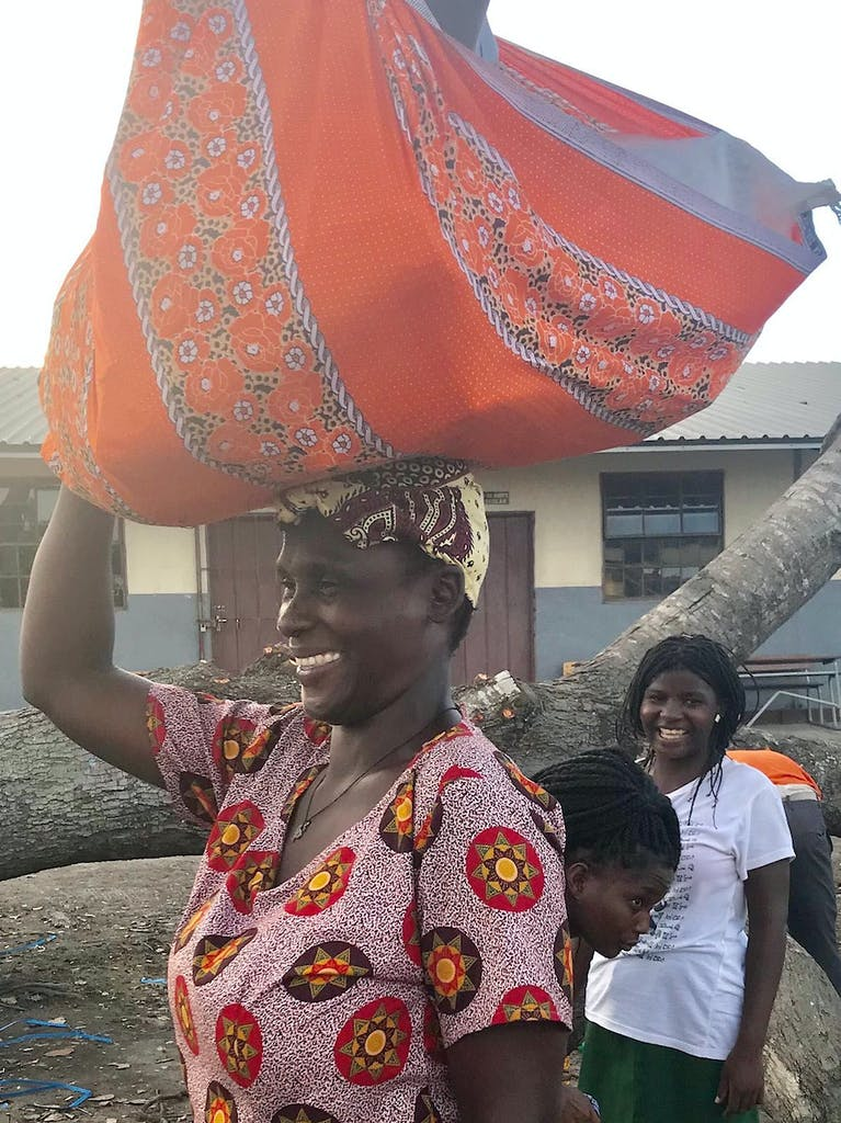woman carrying food on her head