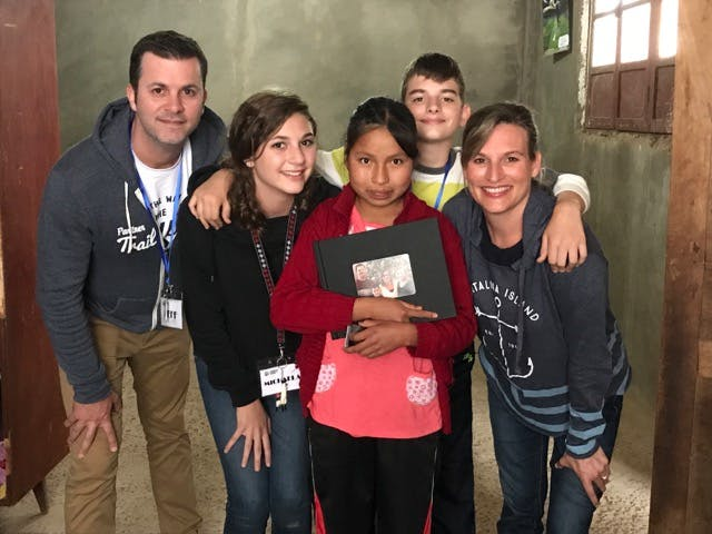 The Schuler family met their sponsored child, Margarita, who treasured the photo book they gave her.