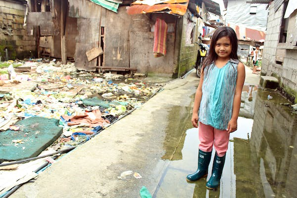 Althea, an 8-year-old girl in the Philippines whose community struggles with the problem of flooding, but has benefited from FH's rubber boots distribution that prevents the spread of diseases.