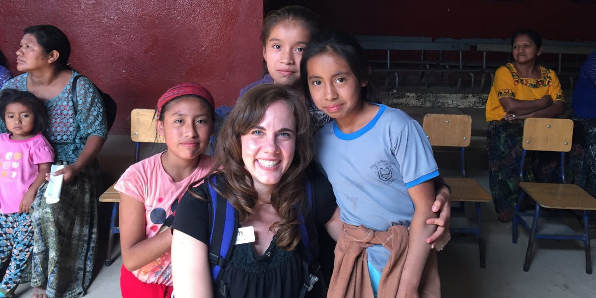 Beth poses with Guatemalan children