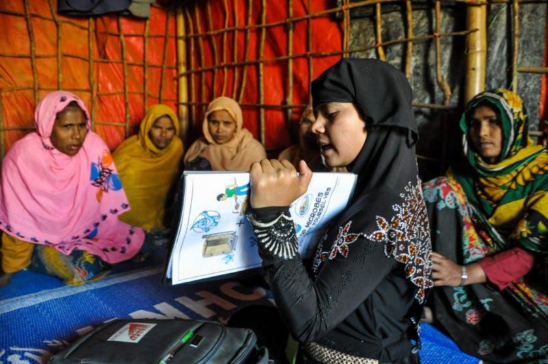 woman teaching other women using health chart