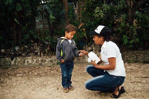 Young boy in the DR receives vitamin, a new item in the FH gift catalog