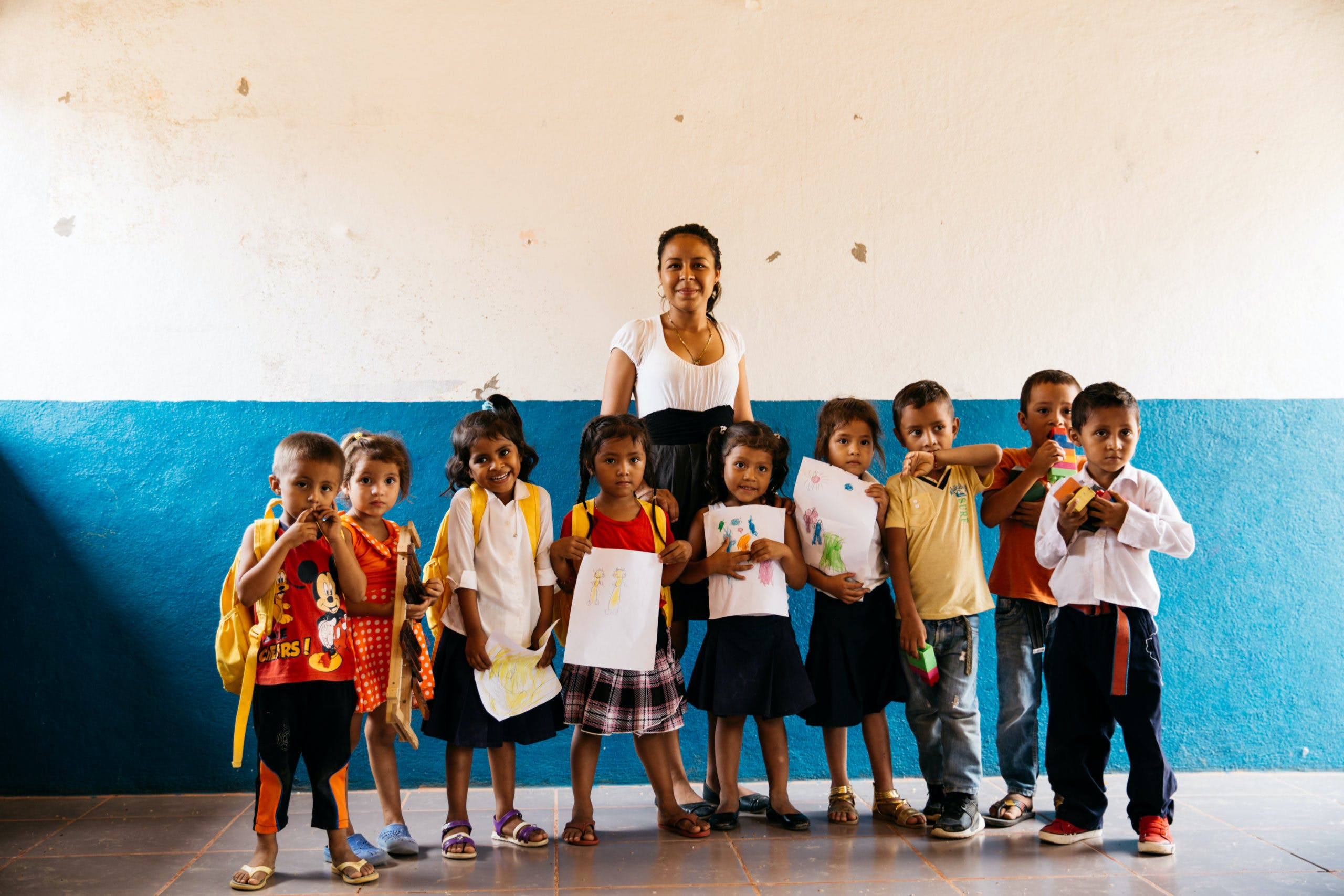 A teacher in her classroom with preschool students