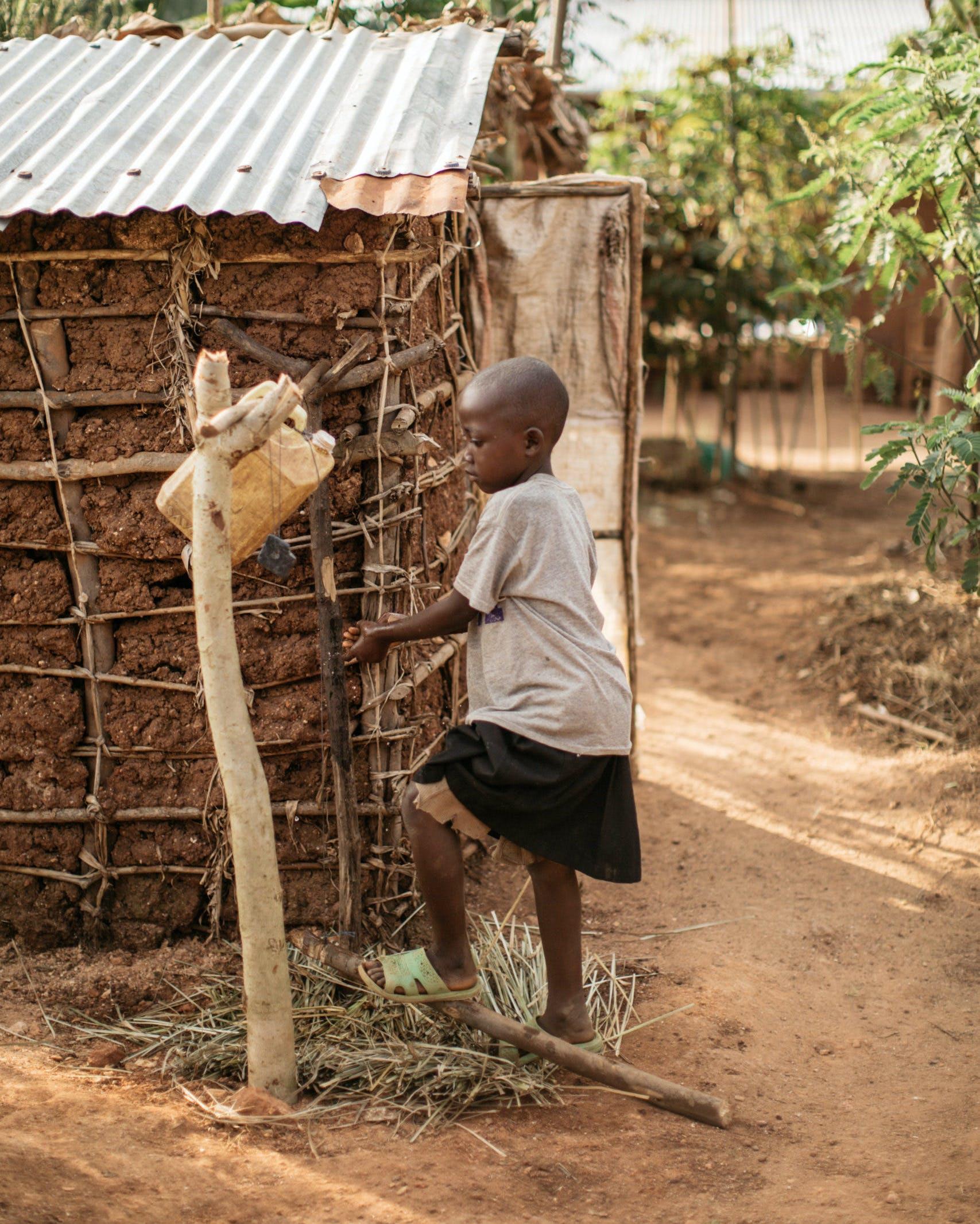 Child washing hands in Burundi