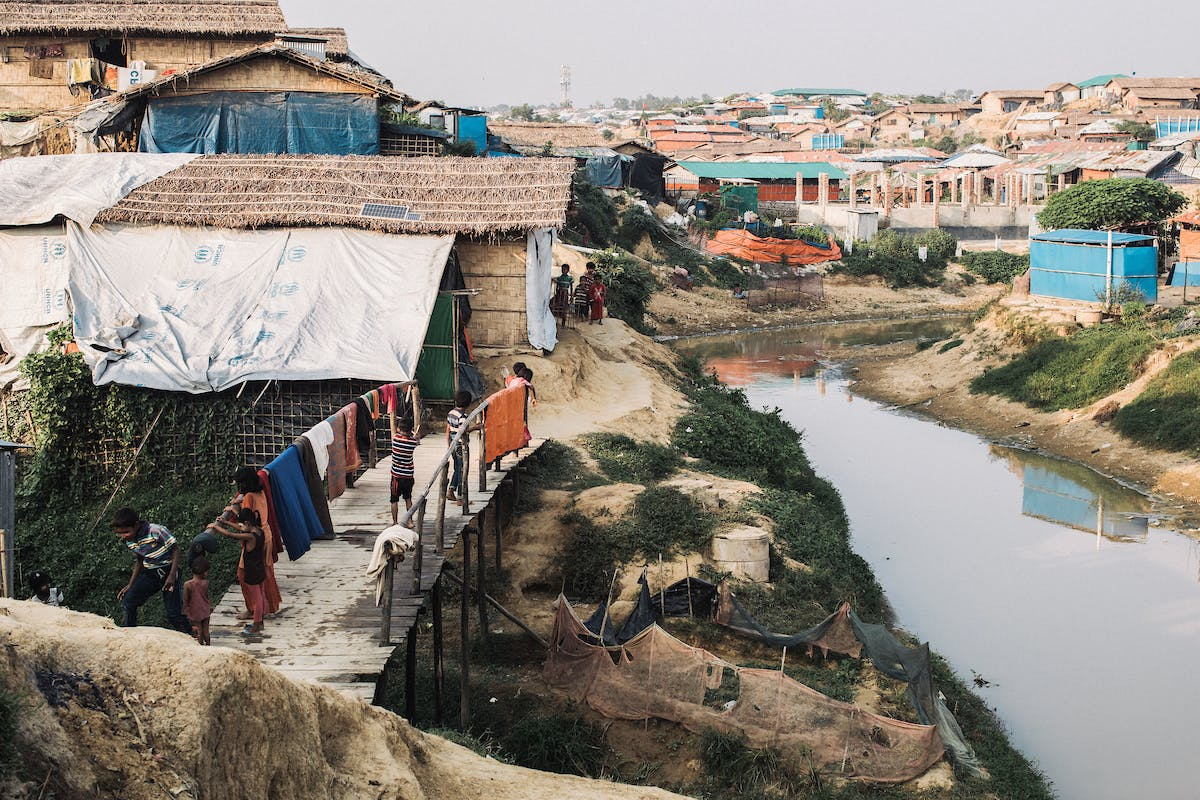 Landscape with tents and river in Rohingya refugee camp, where FH is working to prevent coronavirus in Cox's Bazar