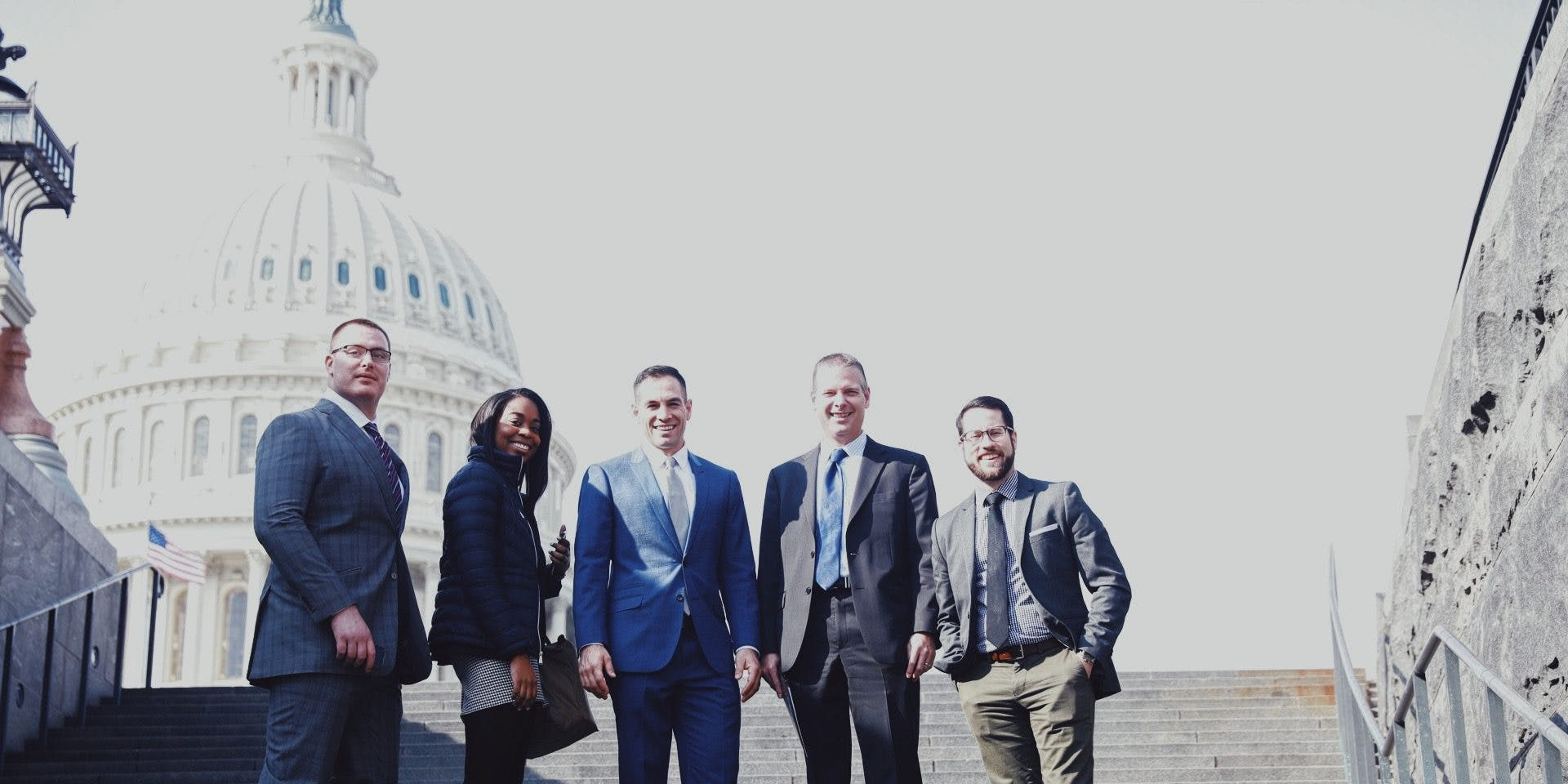 Advocates on Capitol Hill pose on the steps for a photo