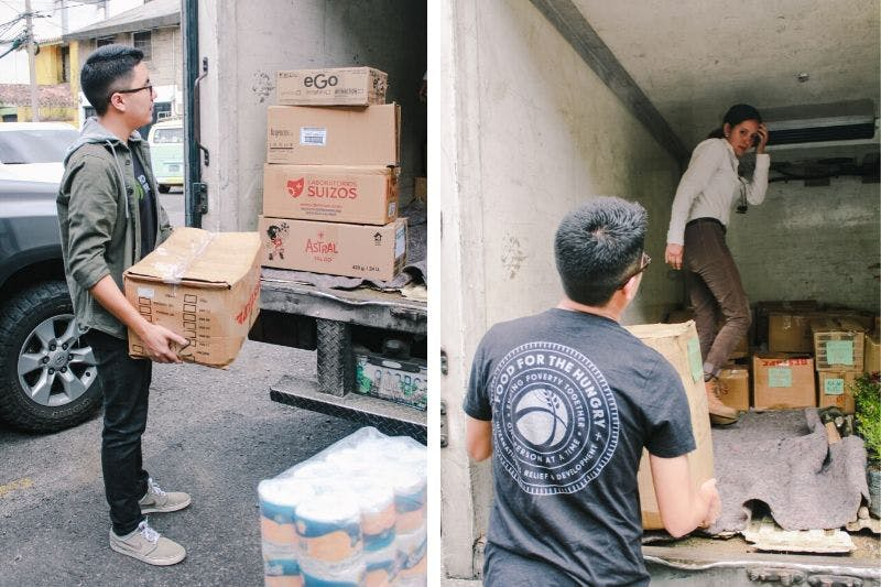 Young men lifting donation of hygiene kits into a truck for Central American migrants