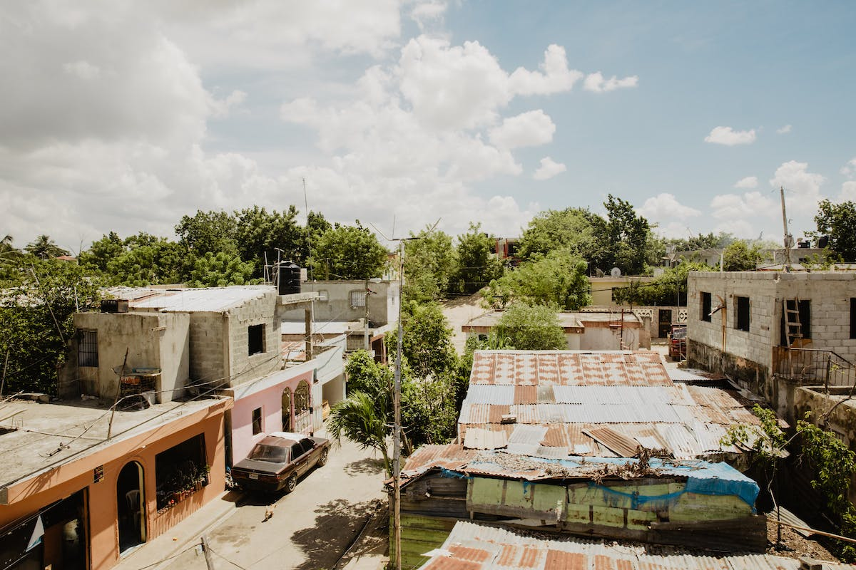 Aerial shot of typical street and neighborhood in the community of El Kennedy in the Dominican Republic