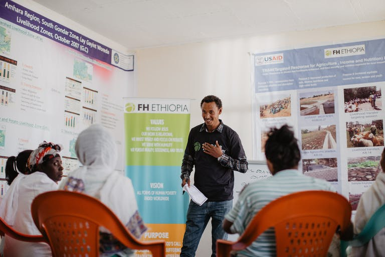 Sintayehu participates in an FH savings group meeting.