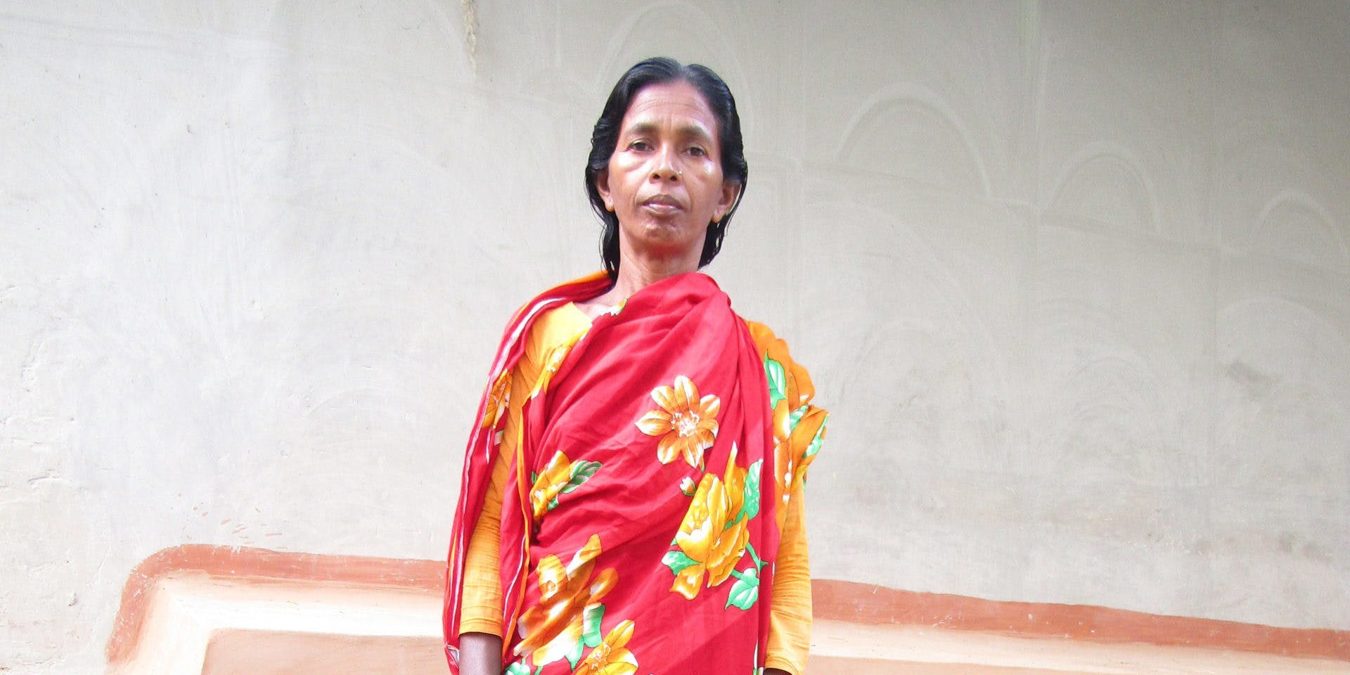 A mother standing in front of a house