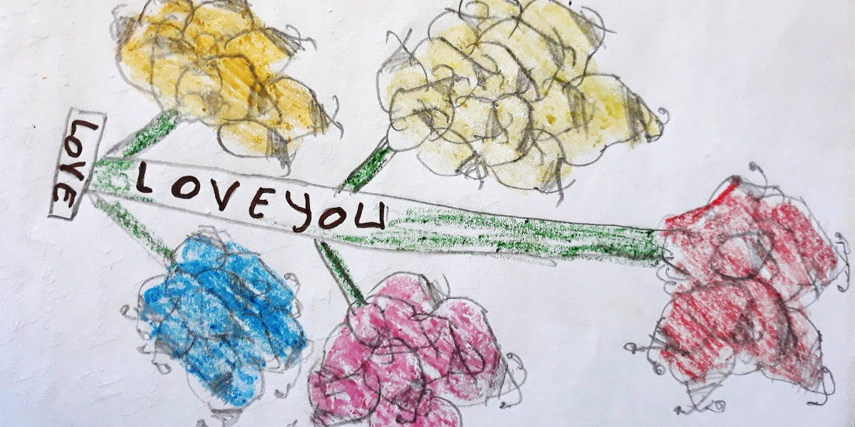 A drawing of a flower and text that reads love you