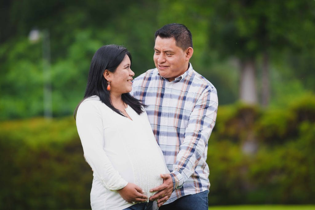 Pregnant woman and her husband, new parents