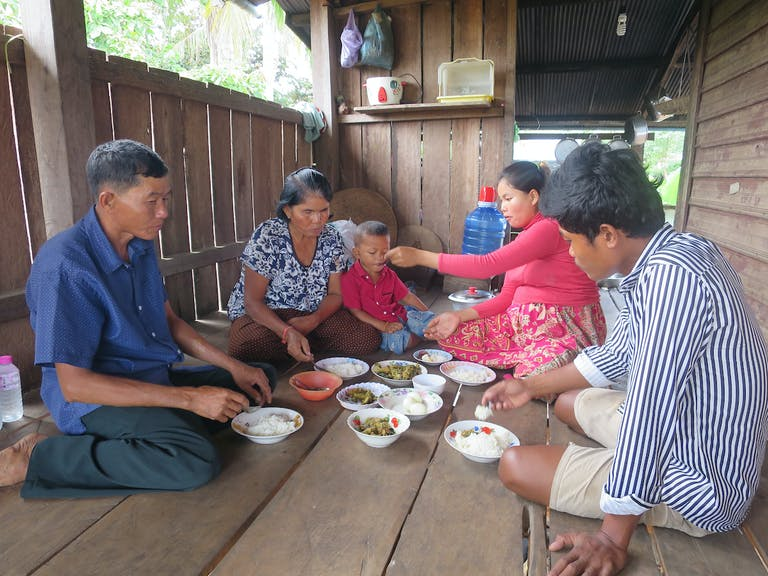 Family from Cambodia eating