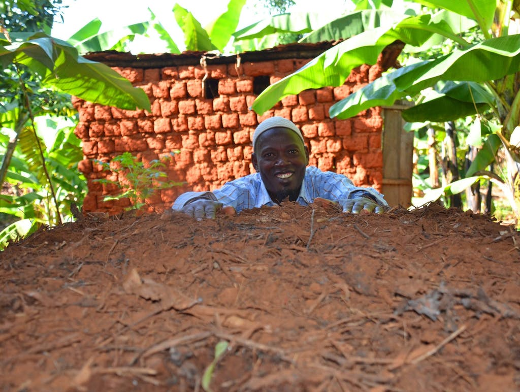 a man next to his compost