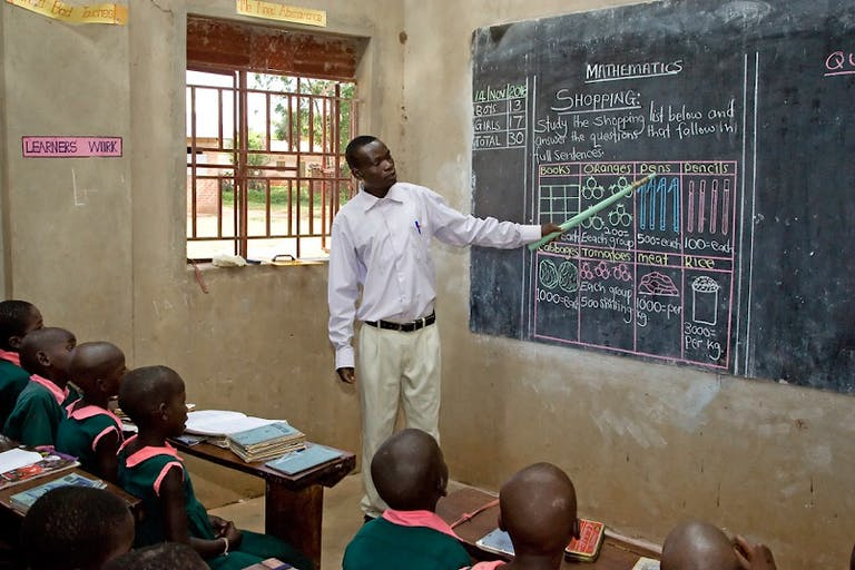 Teacher in Uganda at the blackboard