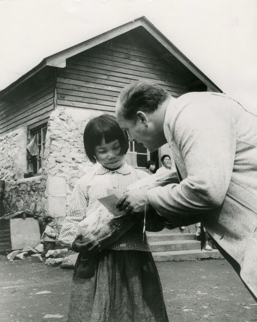 Dr. Ward sharing Bible tract with a little girl