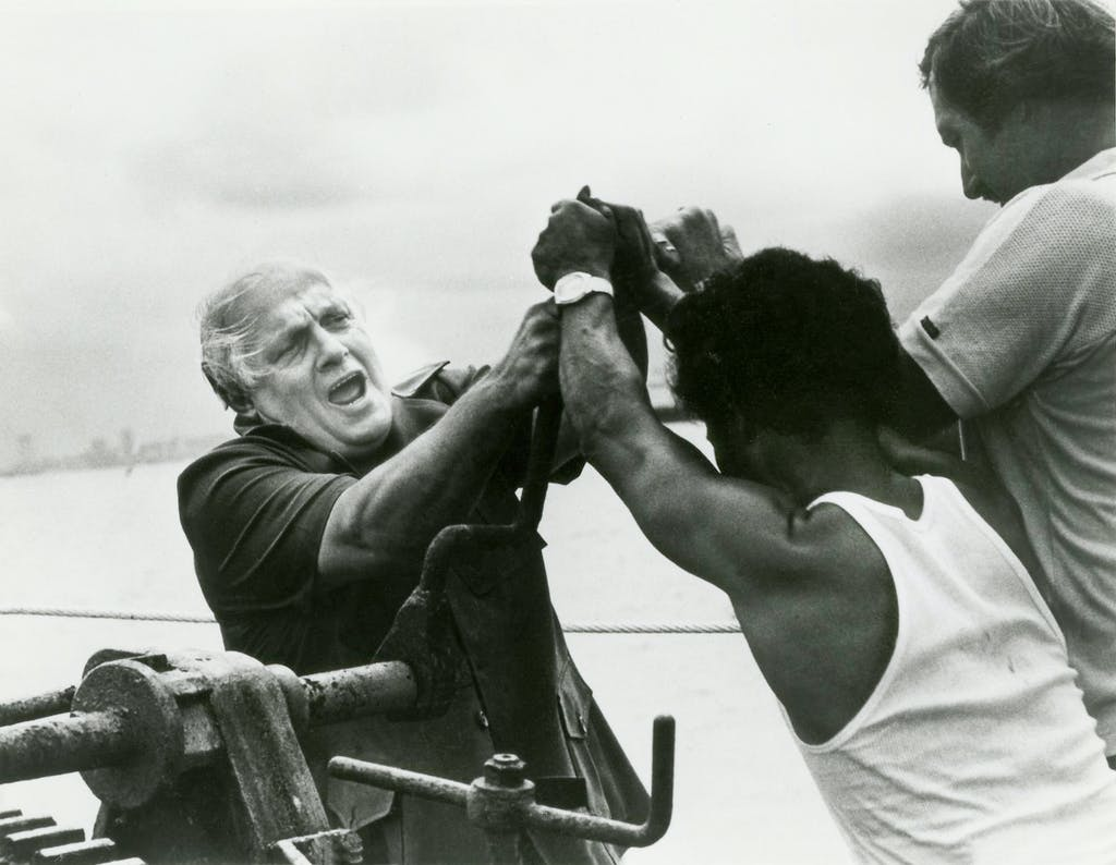 Larry Ward with Vietnamese boat people