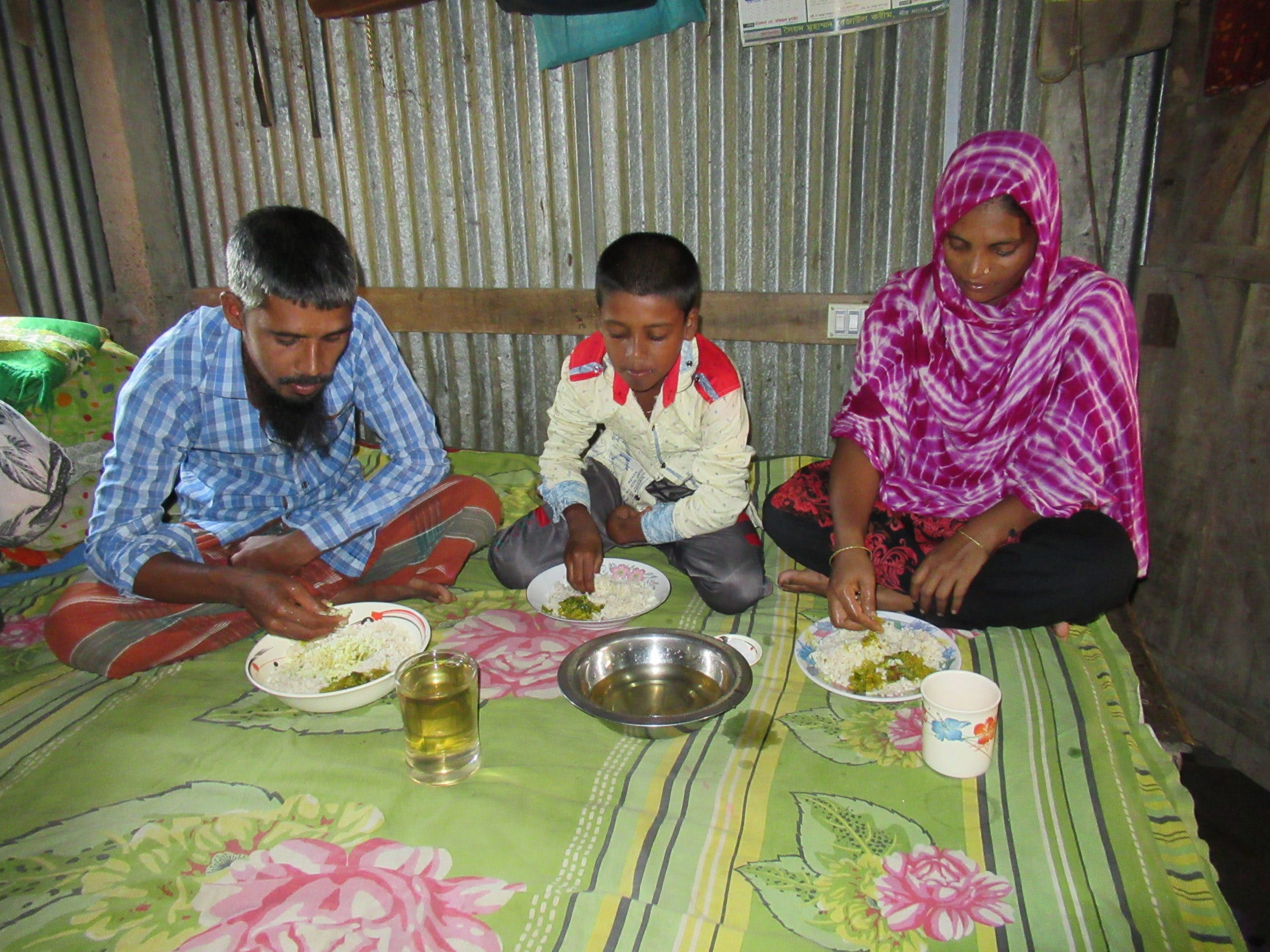 Mustakin and family eating dinner together