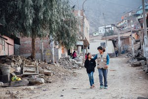 FH Staff Member Walking with a Child