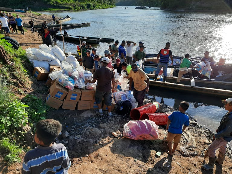 Unloading boats full of relief supplies in Nicaragua
