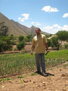 Juan Pablo standing in a field in Bolivia