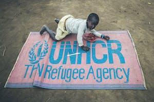 Child with UNHCR Blanket