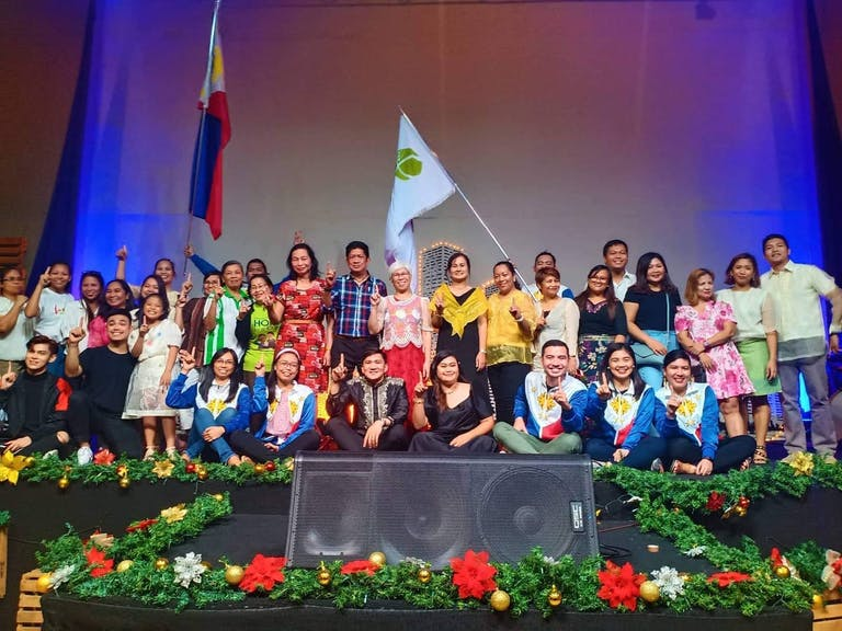 Group shot of FH Philippines staff on a stage
