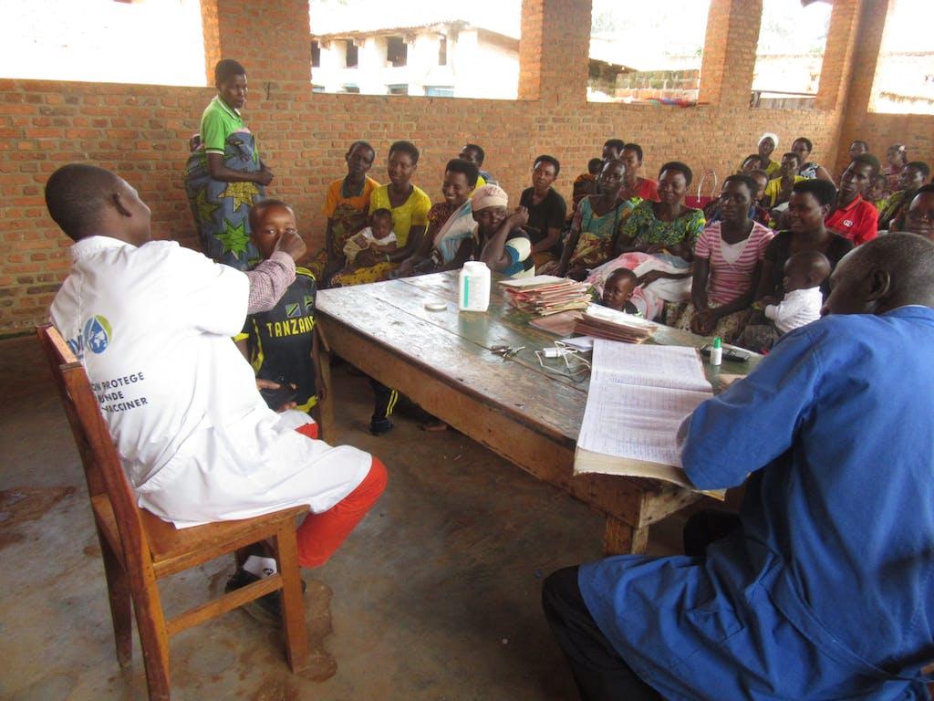 Child taking deworming medication