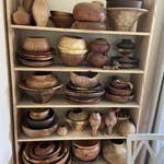 bowls and other items crafted by woodturning on a shelf