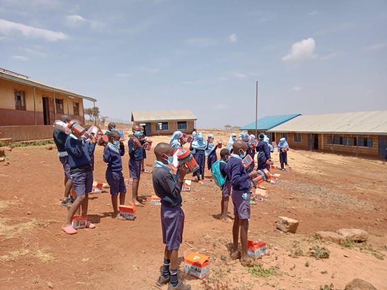 Students in Kenya receive solar lighting packs