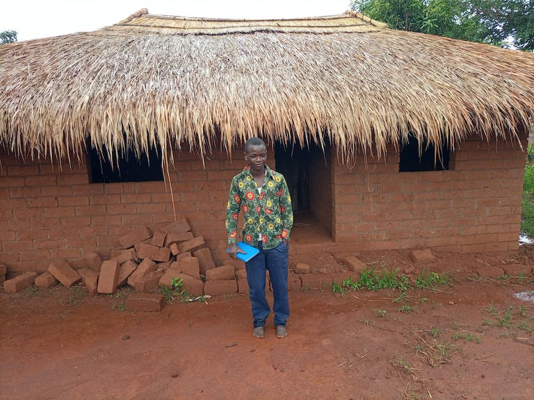 A young participant in the Mutambala Youth Group became secretary of the group and completed FH livelihood training. Soon, he opened a tiny store in the community and, with his proceeds, has built this new home, where he now lives.