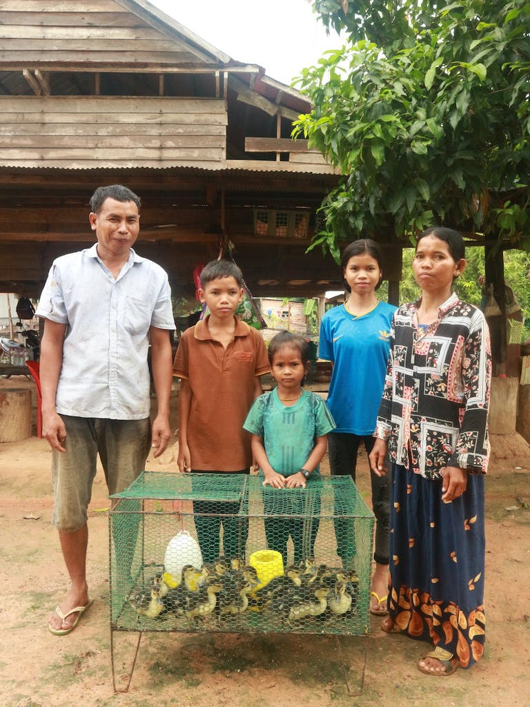 ducks-with-cambodian-family-standing-behind